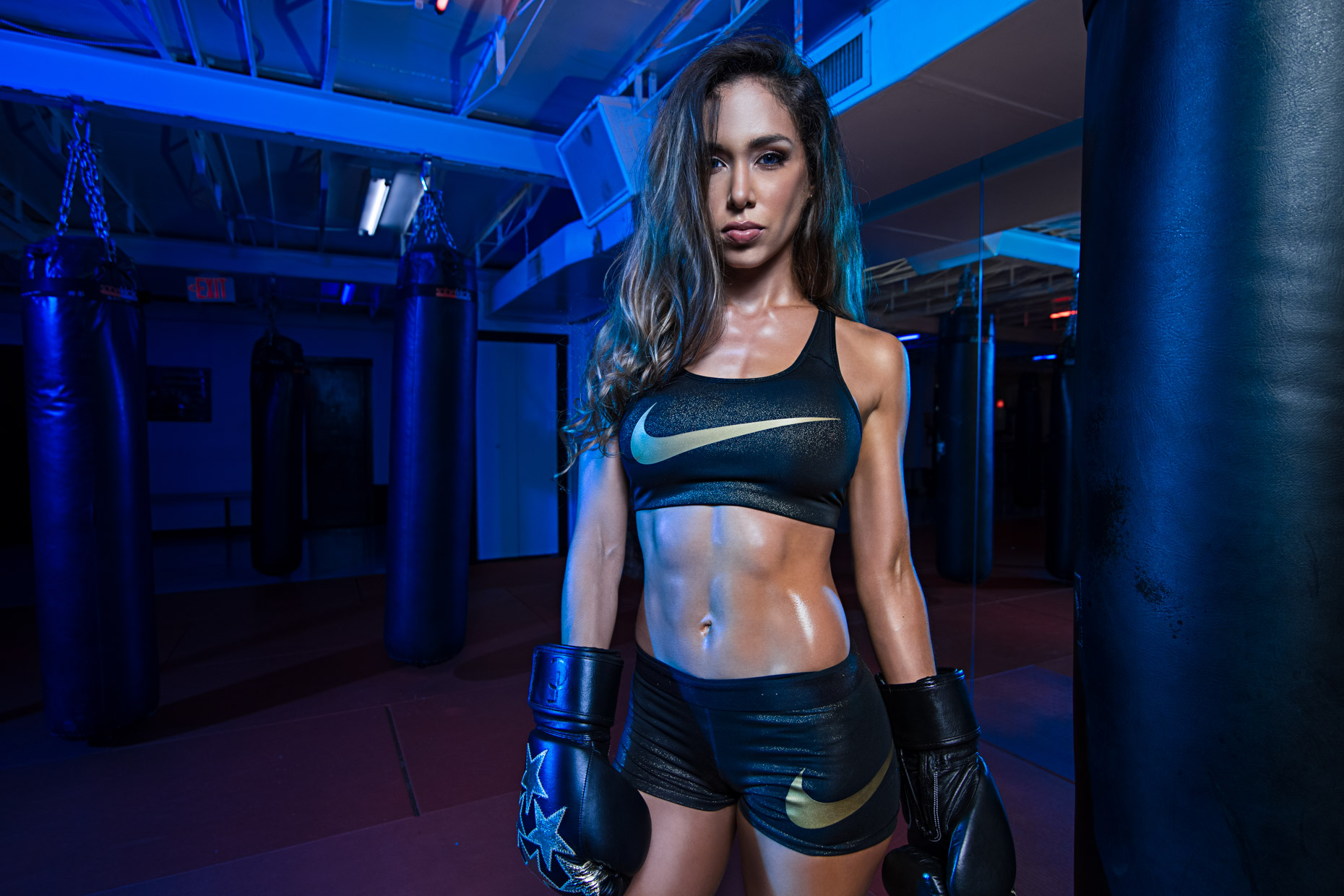 Shay Medal, fitness model and athlete poses in Nike workout apparel for this fitness photoshoot